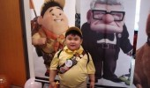 A boy that looks like Russell from the Disney Pixar movie Up.