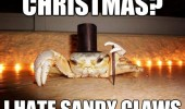 A picture of a fancy crab wearing a top hat and holding a cane. Christmas? I hate sandy claws (Santa Clause).