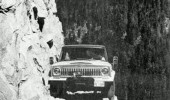 A car driving on a dangerous rocky cliff.