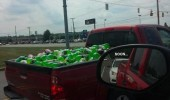 A truck full of Mountain Dew bottles and a car following behind. Soon.