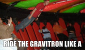 A guy riding the Gravitron at a carnival while standing up.